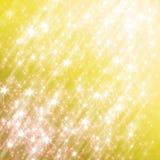 Funkelnder gelber Hintergrund mit Sternen Stockfoto