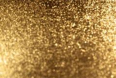 Funkelnder Goldhintergrund Lizenzfreie Stockfotos