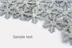 Funkelnder Schneeflockehintergrund Lizenzfreies Stockfoto