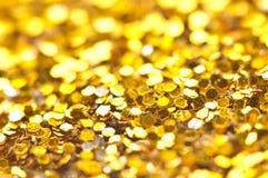 Funkelndes Lichter bokeh Licht goldener Weihnachtshintergrund Lizenzfreie Stockfotos