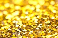 Funkelndes Lichter bokeh Licht goldener Weihnachtshintergrund Lizenzfreies Stockfoto