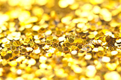 Funkelndes Lichter bokeh Licht goldener Weihnachtshintergrund Lizenzfreie Stockfotografie