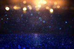 Funkelnweinlese beleuchtet Hintergrund Blau, Gold und Schwarzes De fokussiert Stockbild