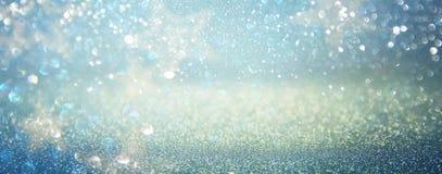 Funkelnweinlese beleuchtet Hintergrund Blau, Silber defocused Stockfoto