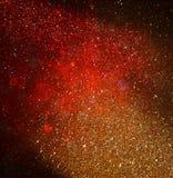Funkelnweinlese beleuchtet Hintergrund dunkles Gold und Schwarzes defocused Lizenzfreies Stockbild