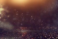 Funkelnweinlese beleuchtet Hintergrund Gold, Blau und Schwarzes Stockfotos