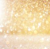 Funkelnweinlese beleuchtet Hintergrund helles Gold und Schwarzes defocused