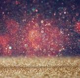 Funkelnweinlese beleuchtet Hintergrund helles Gold und Schwarzes defocused Stockfotos