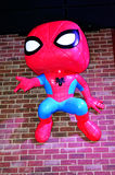 Funko Spiderman hangs from brick wall. Funko Store Spiderman in Everett Washington stock photography