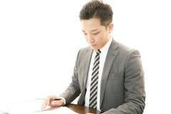 Funktionsduglig asiatisk affärsman royaltyfria foton