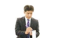 Funktionsduglig asiatisk affärsman arkivfoton