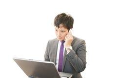 Funktionsduglig asiatisk affärsman arkivfoto