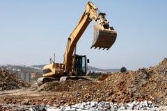 Funktionsduglig grävskopa Arkivfoton