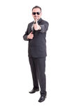 Funky banker showing thumb up Royalty Free Stock Images