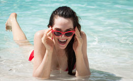 Funky beautiful woman lying in water Stock Photography