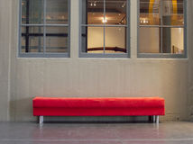 Funky bench. Funky orange bench in old industrial / museum interior Stock Photography