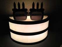 Face - Funky Birthday Glasses with Outdoors Lamp Stock Photography