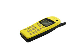 Funky bright yellow retro cellphone. Vintage cellphone in bright yellow isolated with copy space Royalty Free Stock Photos