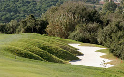 Funky bunker on golf course in Spain. Funky, difficult, hand shaped bunker on golf course in Spain Royalty Free Stock Image