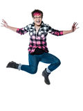 Funky casual young woman jumping in joy Stock Photos