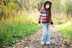 Funky child posing outdoors in colorful blouse Stock Photography