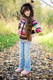 Funky child posing outdoors in colorful blouse Royalty Free Stock Photo
