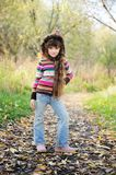Funky Child Posing Outdoors In Colorful Blouse Royalty Free Stock Photos