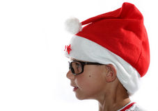 Funky Christmas kid with glasses. Male child with santa hat and glasses stock image