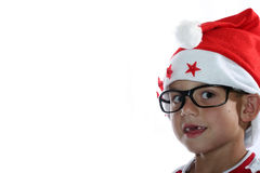 Funky Christmas kid with glasses. Male child with santa hat and glasses royalty free stock image