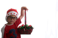 Funky Christmas kid with glasses. Male child with santa hat and glasses stock photography