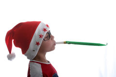 Funky Christmas kid with glasses. Male child with santa hat and glasses royalty free stock photography