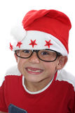 Funky Christmas kid with glasses. Male child with santa hat and glasses stock photo