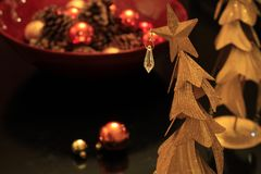 Funky Brass Christmas Tree with ornaments and glitter royalty free stock photo