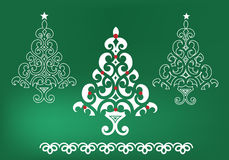 Funky Christmas trees. With loop pattern over green Royalty Free Stock Photos