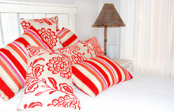 Funky colorful pillows. A bedroom with a collection of colorful pillows Stock Photography
