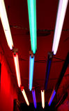 Funky coloured Strip lights. On a deep red ceiling in the entrance to a hip night club Stock Photos