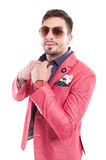 Funky fashionable male model fixing shirt collar Royalty Free Stock Photo