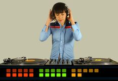 Funky female dj. A funky female dj, mixing on turntables with graphic equaliser designs below royalty free stock image