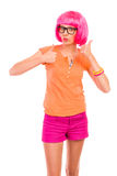 Funky girl in black glasses showing thumbs up. Royalty Free Stock Image