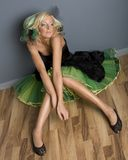Funky Girl in Dress. Funky looking young woman sitting in black and green prom dress stock images