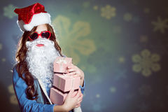 Funky girl in super sunglasses and false santa Stock Images