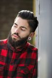 Funky guy with beard and piercings Royalty Free Stock Image