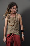 Funky guy with dreadlocks. Portrait of young funky male with long dreadlocks Royalty Free Stock Photography