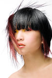 Funky hair. Asian model with colorful makeup and whacky hair on white studio background Stock Photography