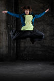 Funky jumping dancer Royalty Free Stock Photos