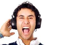 Funky kerel die aan muziek luistert Stock Afbeelding