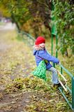 Funky little child girl in autumn atmosphere Stock Images