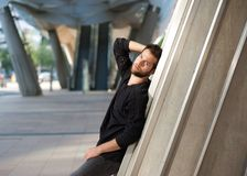 Funky male fashion model standing outdoors Stock Image