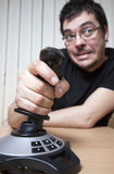 Funky man with a joystick Royalty Free Stock Images