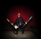 Funky musician with two guitars Royalty Free Stock Photo